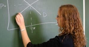 Teacher plotting out concept on chalkboard