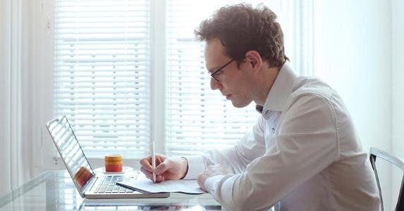 Young man working from home on his laptop © iStock