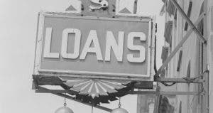 Old 'LOANS' sign on side of building | George Marks/Getty Images