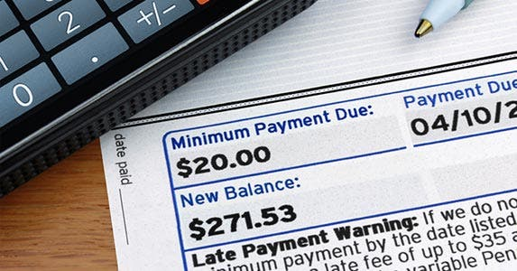 Make late payments | iStock.com/GaryPhoto