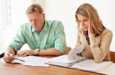 Unhappy couple looking over their finances   iStock.com/alvarez