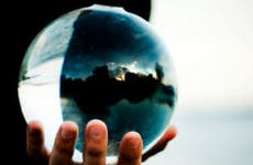 Holding a glass ball | Tyler E Nixon/Moment/Getty Images