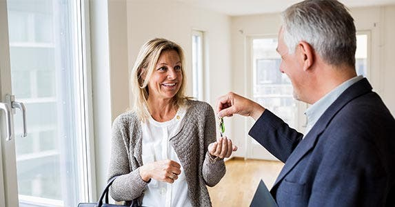 Realtor handing over keys to homebuyer