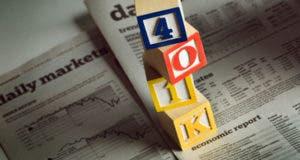 """""""401k"""" toy blocks on top of newspaper"""