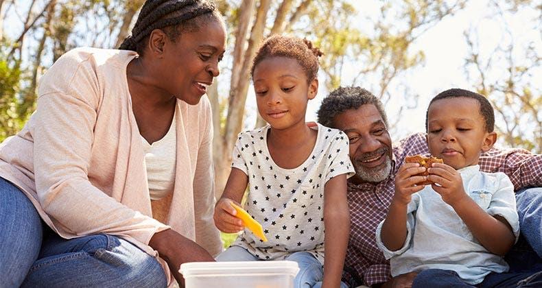 Family Eating Outside Scaling Down A Retirem...