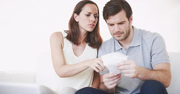 Couple looking over receipts together © iStock