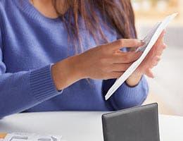 Cashing in rebates © Cheryl Savan/Shutterstock.com