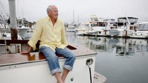Mature man sitting on marina dock | Blend Images - Peathegee Inc/Getty Images