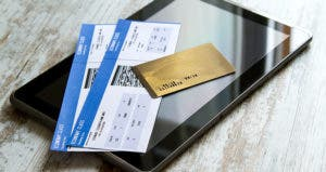 Credit card, airline ticket on top of tablet computer © conejota/Shutterstock.com