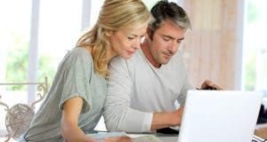 Couple looking at paperwork © Goodluz/Shutterstock.com