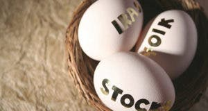 IRA, stock, 401(k) eggs in basket © iStockPhoto.com