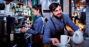 Baristas serving coffee | Studio Romantic/Shutterstock.com