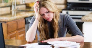 Woman stressed by bills © iStock