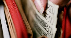 Twenty dollar bills in red wallet