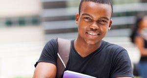 Smiling student holding bag and book © michaeljung/Shutterstock.com