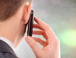 Answer your phone while on the interview © maradonna 8888/Shutterstock.com