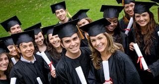 College grads standing in a group © Andres Rodriguez / Fotolia