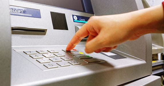 Check for ATM reimbursement © cozyta/Shutterstock.com