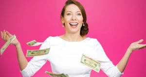 Money falling down around excited woman © PathDoc/Shutterstock.com