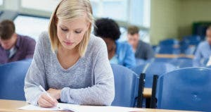Student taking notes in classroom © iStock