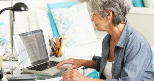 Mature woman working on finances with computer © iStock