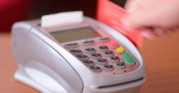 Red card being swiped through machine © iStock
