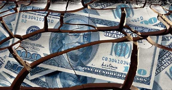 Cracked $100 dollar bill © iStock