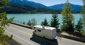 RV driving on road by the mountains | stockstudioX/E+/Getty Images