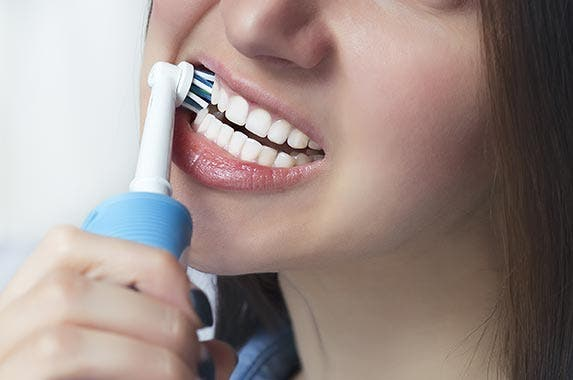 Electric toothbrush | aragorik/Shutterstock.com