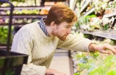 Young man buying produce in grocery store