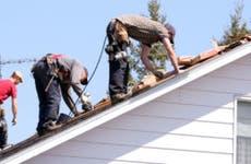 Men repairing roof