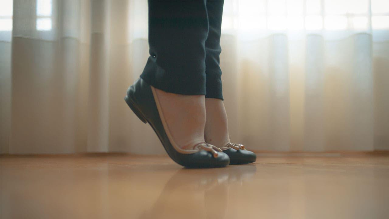 Woman on tiptoes
