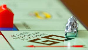 Monopoly board with game piece on Go