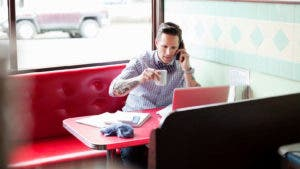 Man in a diner talking on the phone