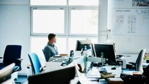 Man sitting alone in an open office