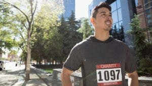 Man excited to start running a marathon
