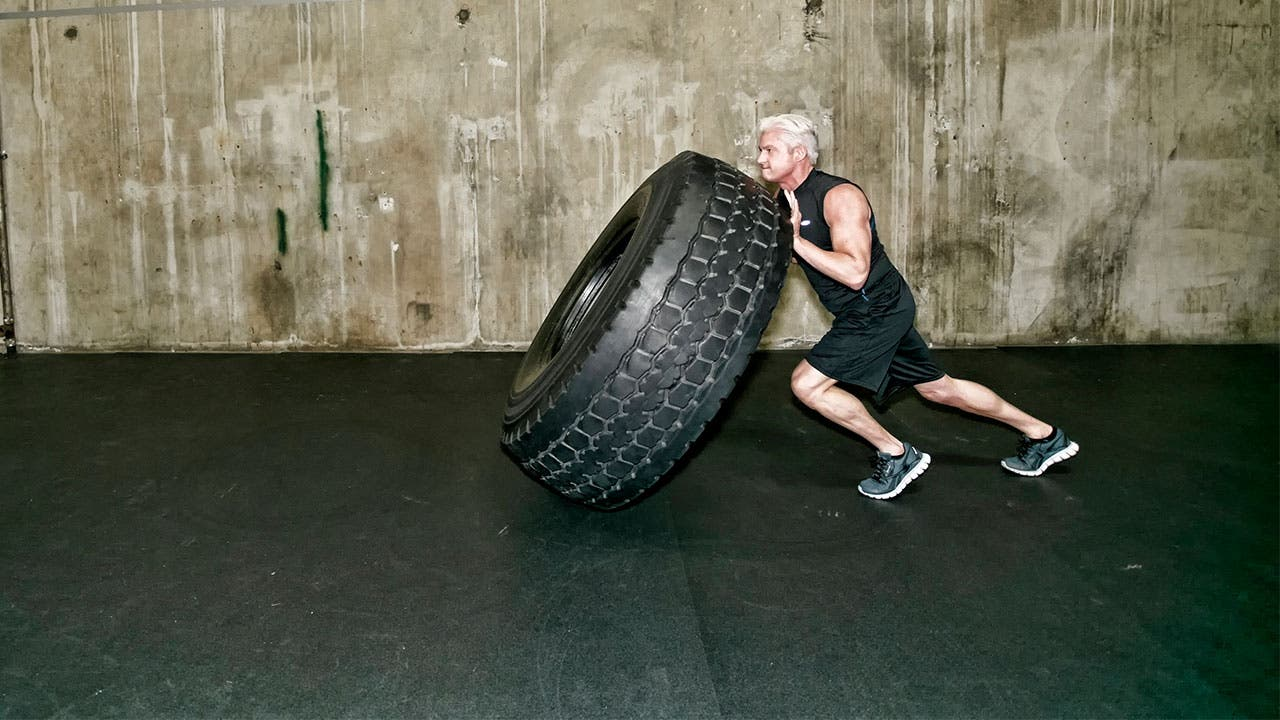 Man working out flipping a tire