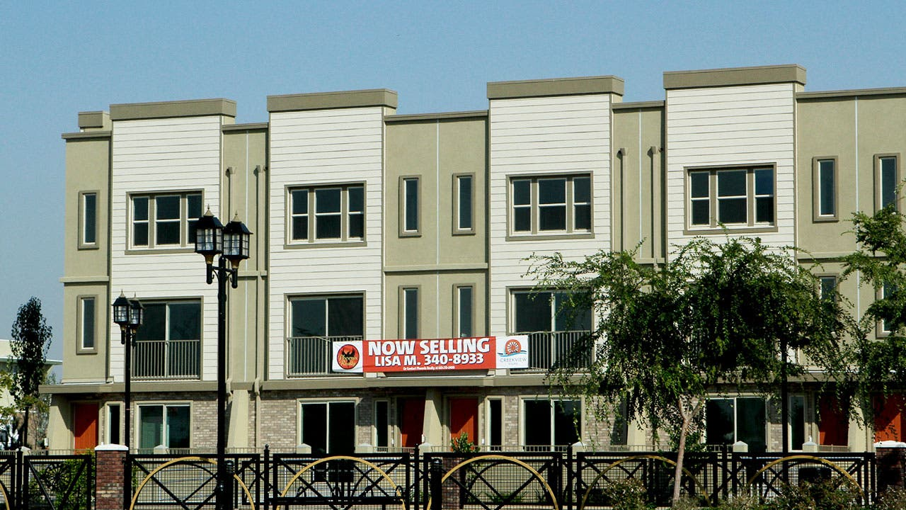 Apartment complex with marketing banner on wall