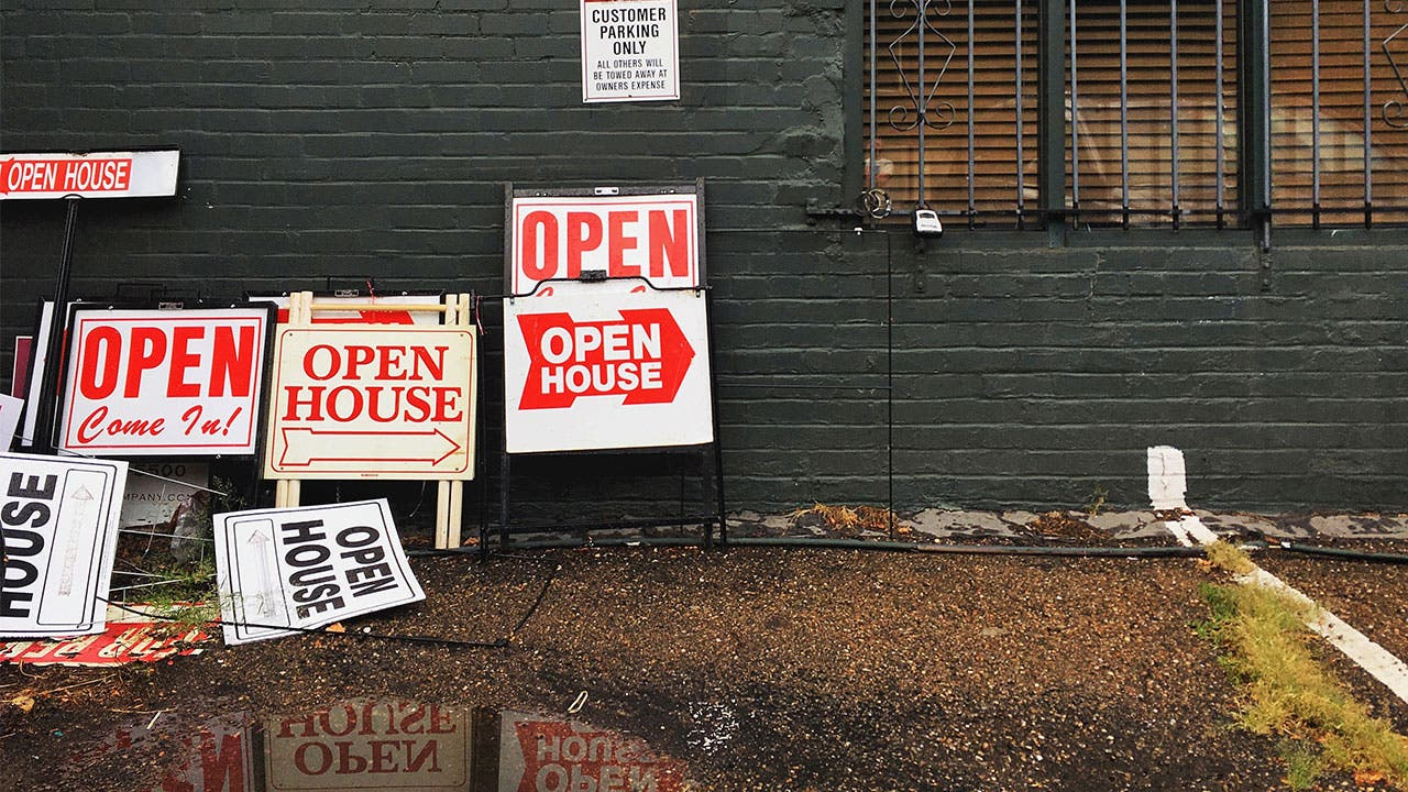Signs pointing to open house