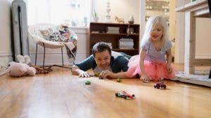 Dad and daughter playing with cars