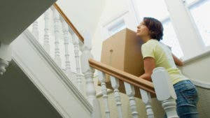 Woman moving into her home