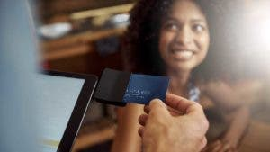Merchant swiping a woman's charge card