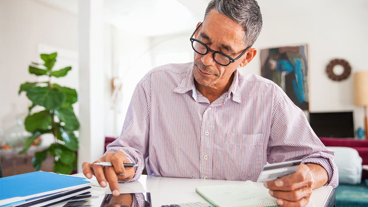 Man doing calculations at desk