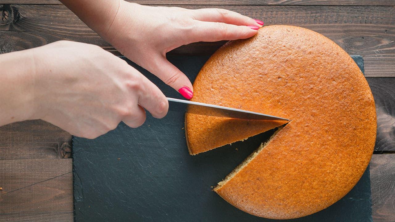 Woman cutting cake