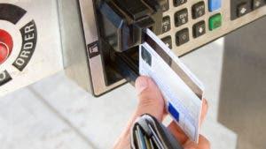 Man sliding credit card