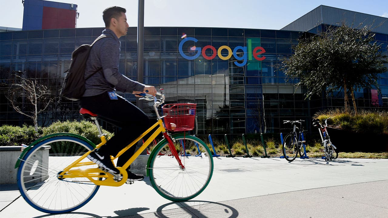 Man riding a bicycle on Google campus