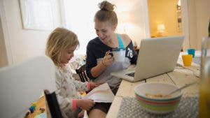 Mother and daughter in front of computer