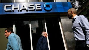 People walk past Chase bank