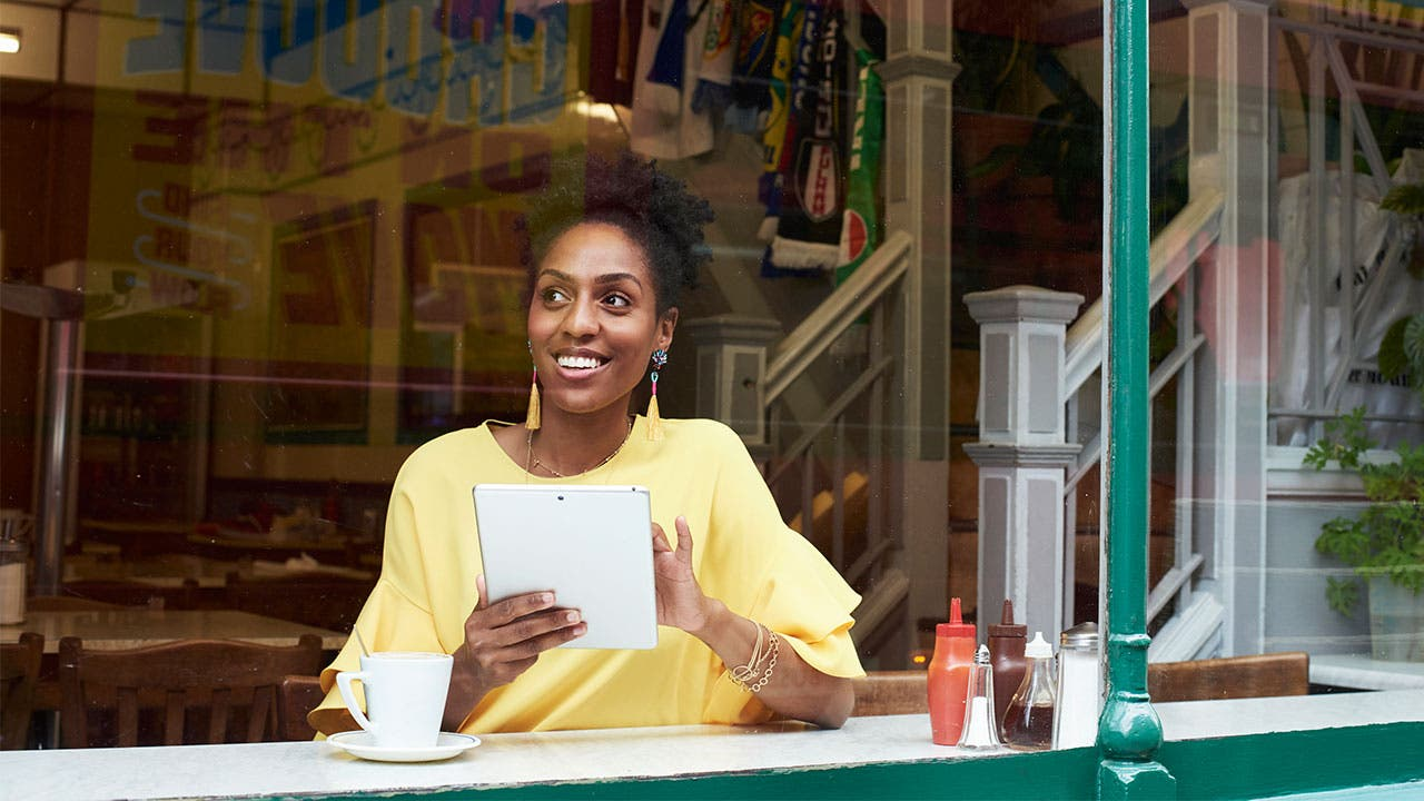 Woman in coffeeshop looking out the window
