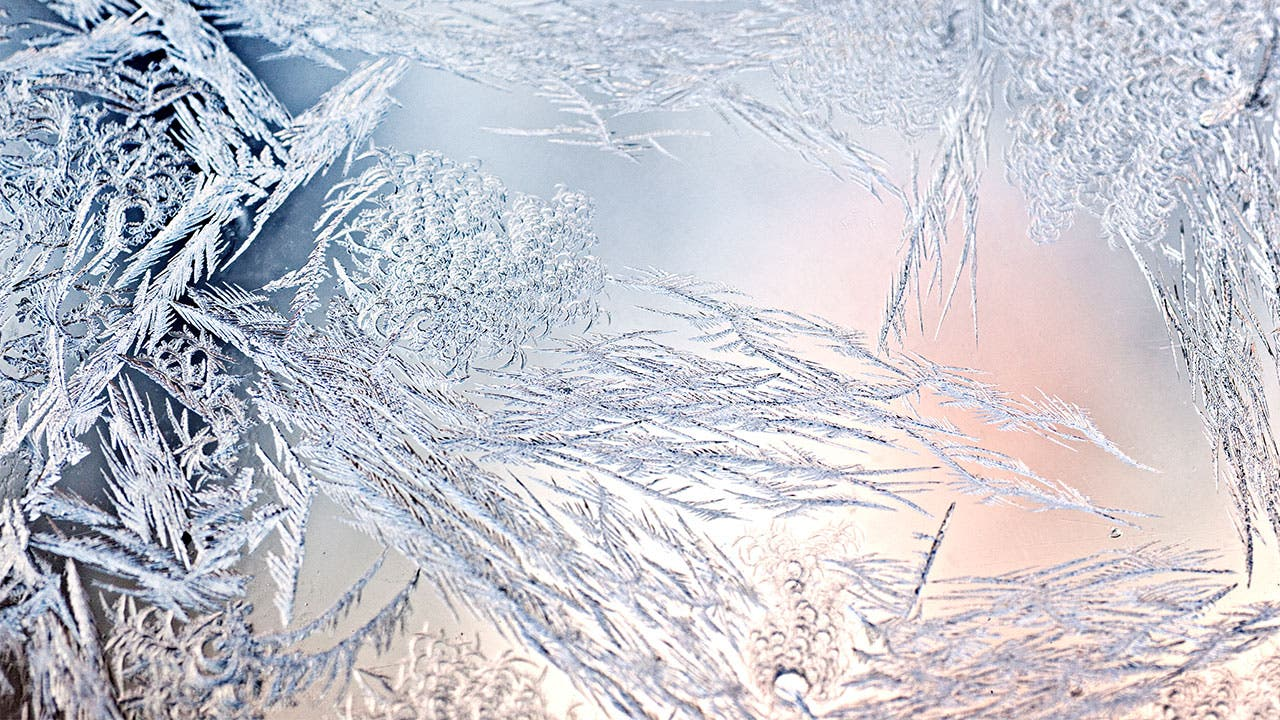 Frozen ice through a sunset
